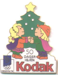 Kodak with number mascots Kristin and Håkon with a christmas tre